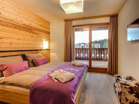 Alpine Lodge Lenzerheide - kids-campings - slaapkamer in het appartement