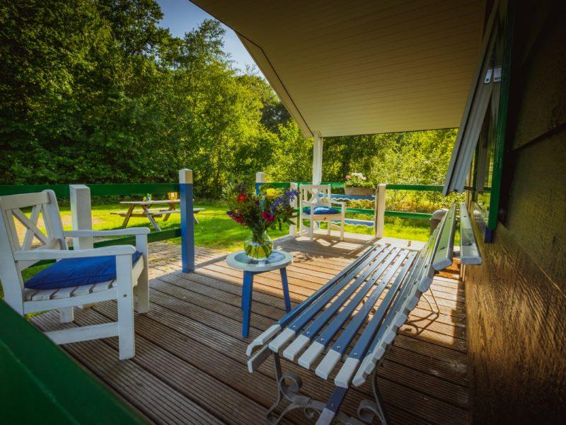 Staphorsthuisje veranda - De Vossenburcht - Kids-Campings